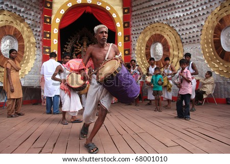 KOLKATA - OCTOBER 16: Devotees performing dance in front of temples during Durga Puja festival on October 16, 2010 in Kolkata, India. - stock photo