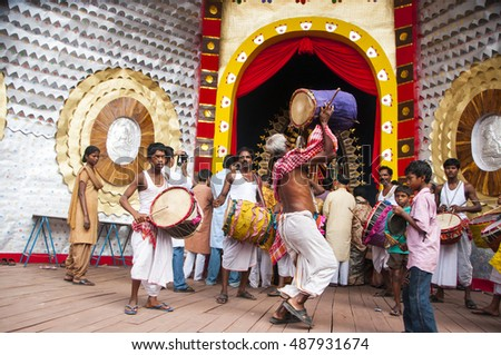 KOLKATA - OCTOBER 17: Devotees playing drums and performing dance at pandal  in front of Durga Idol during Durga Puja festival, on October 17, 2010 in Kolkata, India.