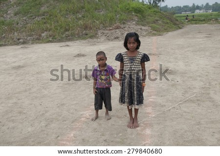 KOLKATA - OCTOBER 26:Kids of Brick factory workers posing for a picture where their parents work and stay in tough conditions without any safety or social security on October 26,2014 in Kolkata,India. - stock photo