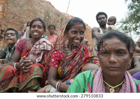 KOLKATA - OCTOBER 26 :Women workers of a brick factory in different moods while sitting in a group inside a brick factory on October 26, 2014 in Kolkata , India.