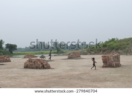 KOLKATA - OCTOBER 26 : Workers working in a brick factory where they live and stay on October 26, 2014 in Kolkata , India. - stock photo