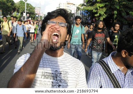 KOLKATA- SEPTEMBER 18: during a student protest rally organized by Jadavpur university students against police atrocities on September 18, 2014 in Kolkata, India. - stock photo