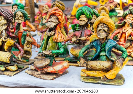 KOLKATA, WEST BENGAL , INDIA - DECEMBER 14TH 2013 : Dolls, Artworks of handicraft, on display during the Handicraft Fair in Kolkata - the biggest handicrafts fair in Asia. - stock photo
