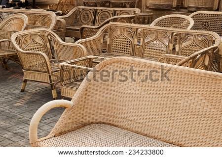 KOLKATA, WEST BENGAL , INDIA - NOVEMBER 23RD 2014 : Cane furniture, handicrafts on display during the Handicraft Fair in Kolkata - the biggest handicrafts fair in Asia. - stock photo