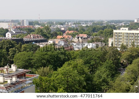 KOLOBRZEG, POLAND - JUNE 25, 2016: Aerial view towards residential buildings that are located among green areas in the city that offers significant number of apartments to rent due to holiday location