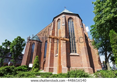 KOLOBRZEG, POLAND - JUNE 23, 2016: Made of brick the massive building was built in Gothic style and it is Basilica of the Assumption of the Blessed Virgin Mary, the Roman-Catholic temple  - stock photo