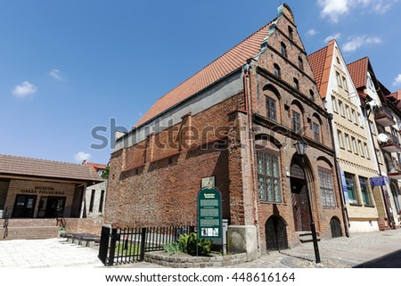 KOLOBRZEG, POLAND - JUNE 23, 2016: Made of brick Townhouse of Merchants was built early of the 15th century, destroyed during the war then reconstructed in the years 1957-1963 - stock photo
