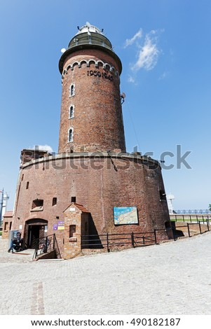 KOLOBRZEG, POLAND - JUNE 22, 2016: Massive building of the lighthouse that is made of brick. This is one of the most recognizable and most visited tourist attractions in the city.