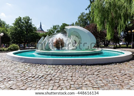KOLOBRZEG, POLAND - JUNE 23, 2016: The famous fountain located in the Pioneer Square is known as the Flower, it was restored in 2013 - stock photo