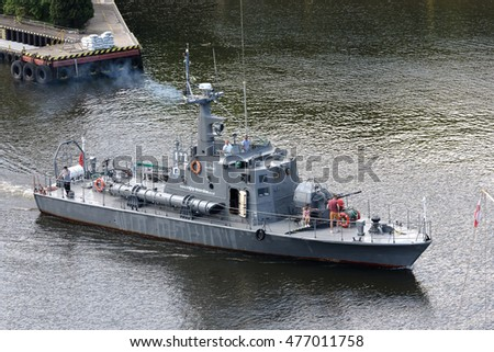 KOLOBRZEG, POLAND - JUNE 22, 2016: Torpedo boat on the waterway from port. The boat was decommissioned in 2001 and was later adapted for the sightseeing cruises, it is shown how departs from port.