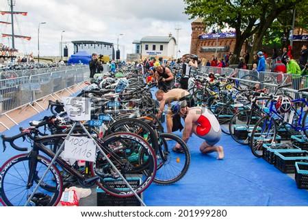 KOLOBRZEG, POLAND - JUNE 20: Triathletes on transition zone of Triathlon event in Kolobrzeg, Poland on June 20, 2014. - stock photo