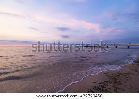 Kolobrzeg, Poland pier. Baltic sea sunset shore landscape - stock photo