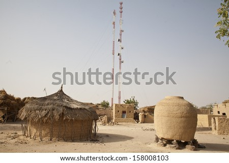 KOLOMBOUTEJ VILLAGE, NIGER - FEBRUARY 2013: Telecommunications antennas hanging over the village of Kolomboutej.