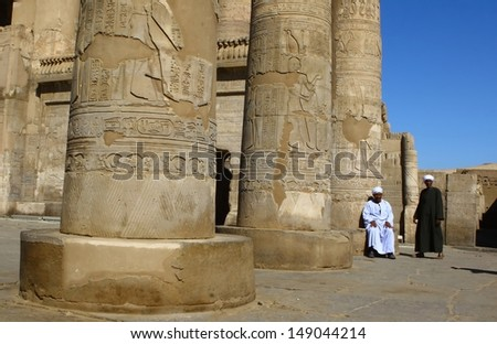 KOM OMBO, EGYPT-DEC 15:Guards at ruined pillars on the temple Kom Ombo that known as two temples consisting of a Temple to Sobek and a Temple of Haroeris on Dec. 15, 2007 at Kom Ombo, Egypt