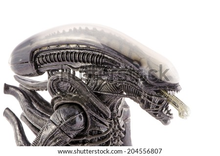 Komarom, Hungary - June 28, 2014: This is a 9 inches tall action figure by Neca Toys. This plastic model represents the monster from the original Alien movie (1979). / Alien head and inner jaws