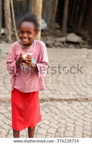KOMBOLCHA, ETHIOPIA-MARCH 24: Young girl plays with a plastic ball she has in hand on March 24, 2013. Kombolcha town at 1842 ms.-Debub Wollo zone-Amhara region-Ethiopia.