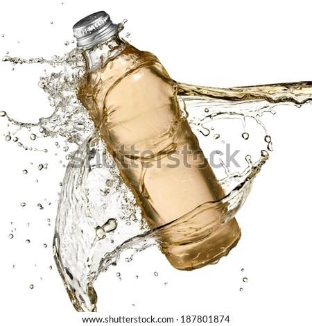 Kombucha bottle splash - stock photo