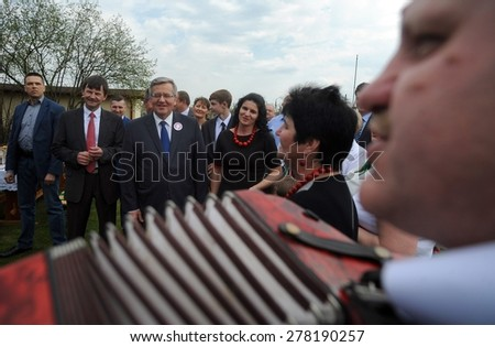 KOMOROW, POLAND - MARCH 08, 2015: President of the Republic of Poland Bronislaw Komorowski during presidential election campaign in apple orchard company