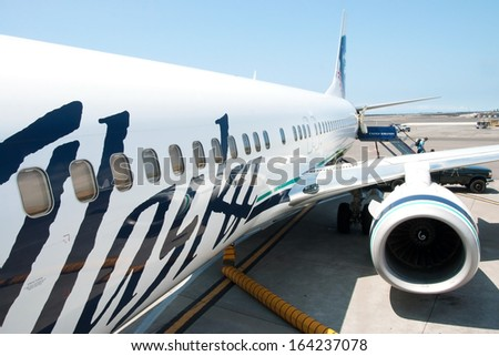 KONA, HAWAII - SEPTEMBER 6, 2011 - Boeing Alaska Airlines ready to boarding in Kona at Keahole airport on September 6, 2011 in Kona, Hawaii. Much of runway is build on relatively recent lava flow. - stock photo
