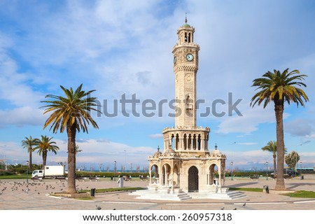 Konak Square street view with old clock tower. It was built in 1901 and accepted as the official symbol of Izmir City, Turkey - stock photo