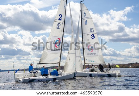 Konakovo , April 19 : Team athletes participating in the sailing competition - match race , held in Konakovo on river Volga April 19, 2016