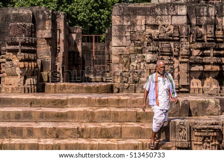 KONARK - SEPTEMBER 25: An unidentified hindu priest walks down the stairs of ancient Sun temple on September 25, 2016 at Konark, Odisha, India.