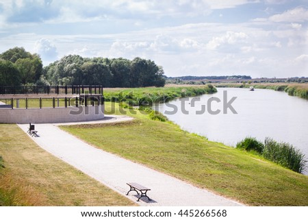 Konin, Poland - June 18, 2016: View on embankment of Warta river in polish town Konin, Greater Poland province