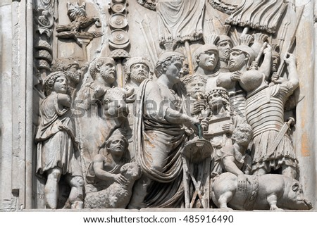 Konstantin arch, Rome, Italy. A bas-relief with the image of the emperor which sacrifices to gods a pig, a sheep and a bull.
