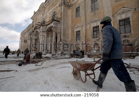 Konstantinovsky  palace - Vladimir Putin's president residence during reconstruction. The worker with a wheelbarrow on a background