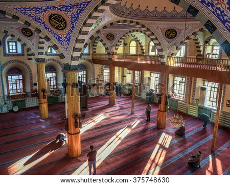 KONYA, TURKEY - FEBRUARY 10: An unidentified muslim man prays Kapu Mosque on February 10, 2016 in Konya, Turkey. Kapu mosque was built in 1658 for the first time. Last form was built in 1868. - stock photo