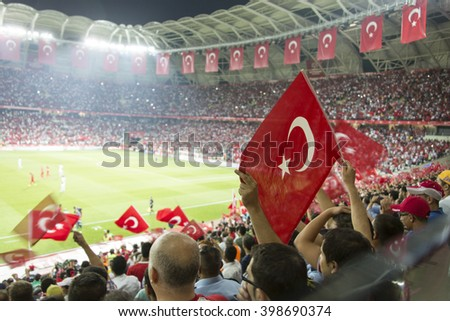 Konya, Turkey - SEPTEMBER 3 Turkish-Latvian fans during the EURO 2015 soccer game on September 6, 2011 in Konya, Turkey. The game is a draw.