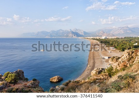 Konyaalti Beach at Antalya in Turkey with Bydaglari Mountains in the background.