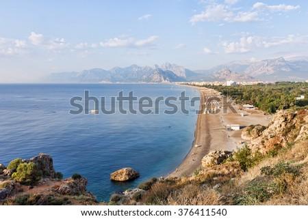 Konyaalti Beach at Antalya in Turkey with Bydaglari Mountains in the background. - stock photo