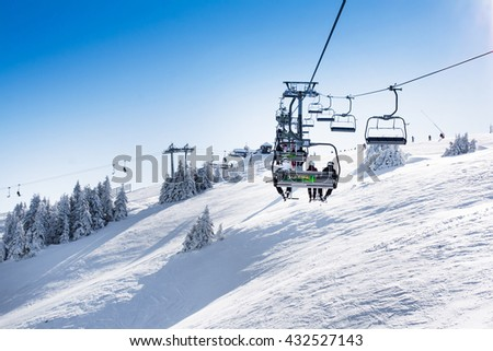 Kopaonik, Serbia - January 22, 2016: Ski resort Kopaonik, Serbia, ski slope, people on the ski lift, skiers on the piste, sun rays
