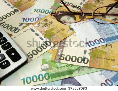 Korea banknotes with calculator and glasses. Business concept.