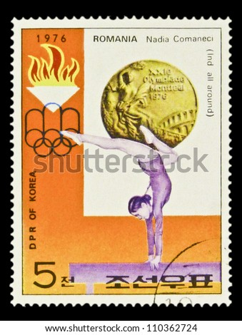 "KOREA - CIRCA 1976: stamp printed in North Korea, shows Gold Medal, emblem of Games, with inscription ""Gymnastics, Nadia Comaneci"", from series ""Summer Olympic Games 1976, Medal Winners"", circa 1976 - stock photo"