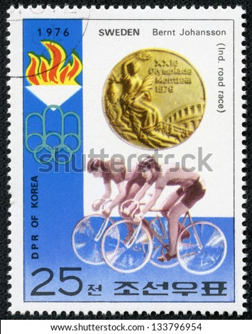 "KOREA - CIRCA 1976: stamp printed in North Korea, shows Gold Medal, emblem of Games, with inscription ""Cycling, Bernt Johansson, Sweden"", series ""Summer Olympic Games 1976, Medal Winners"", circa 1976 - stock photo"