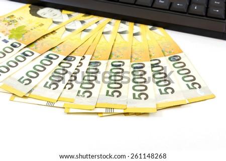 Korea money with keyboard on white background - stock photo