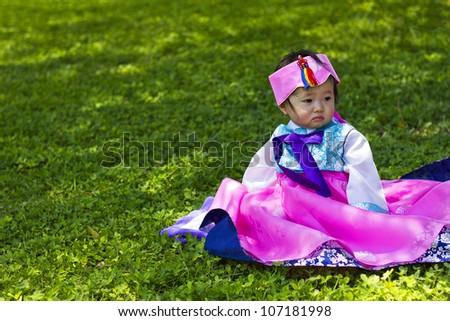 Korean Baby wearing a Traditional Hanbok - stock photo