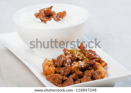 korean beef barbeque with rice cakes and rice on a side - stock photo