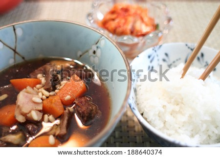 "Korean beef stew known as ""kalbi jim"" with a bowl of white rice."