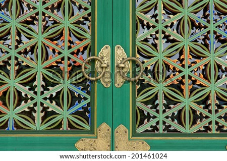Korean Buddhist temple door knob and wall patterns - stock photo