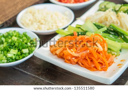 Korean cabbage kimchi salad with hot pepper vegetable and rice set - stock photo
