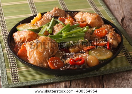 Korean cuisine Dakjim: chicken with vegetables and sesame close-up on a plate. horizontal - stock photo