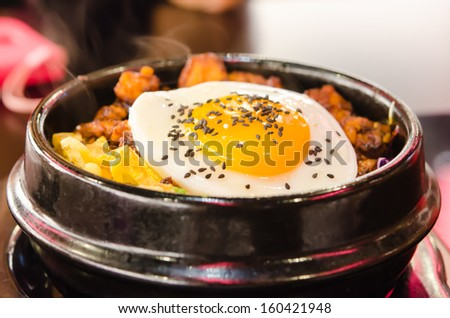 korean food  , bibimbap in a heated stone bowl ,  hot and delicious - stock photo