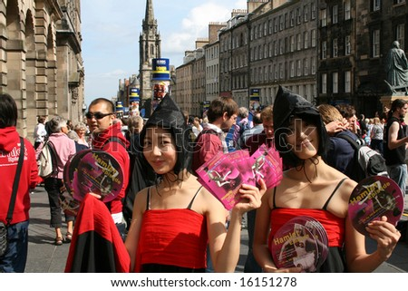 korean girls with flyers members of Daegu City Modern Dance Company on Royal Mile during Edinburgh festival 2008
