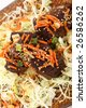 Korean Short Ribs with Sesame Seeds on Cabbage. - stock photo