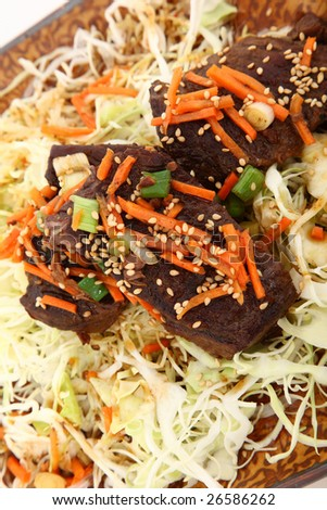 Korean Short Ribs with Sesame Seeds on Cabbage.
