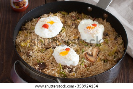 Korean Stir-Fried Rice with a Poached Eggs - stock photo
