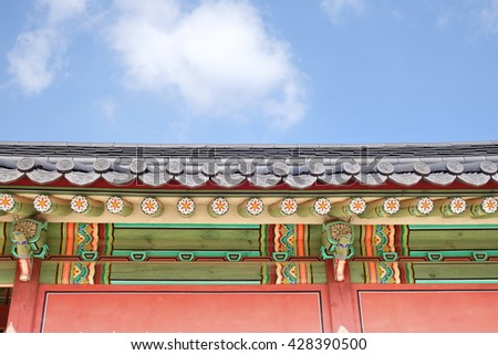 Korean traditional architecture. Roof detail of palace in Seoul. These places are major tourist attraction of  South Korea. - stock photo